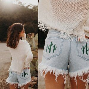 Mumu Blue Wyoming Distressed Cactus Cutoff Shorts